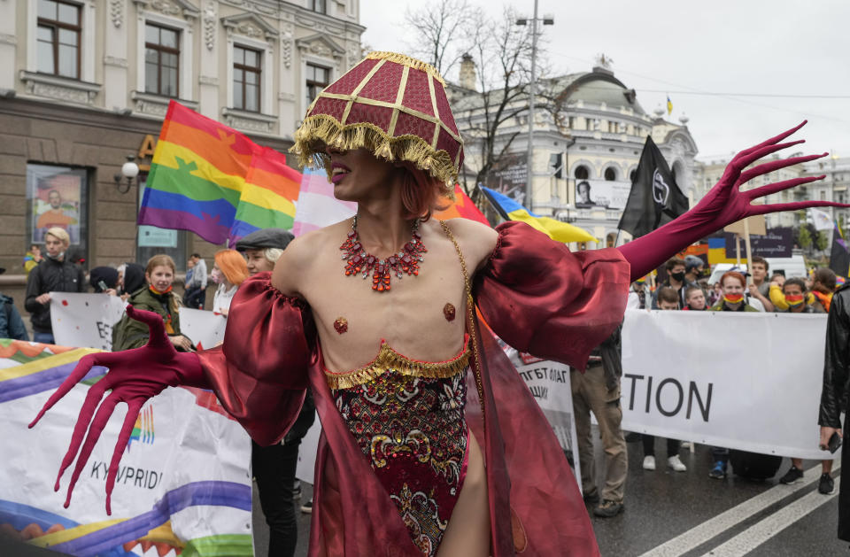 People take part in the annual Gay Pride parade, under the protection of riot police in Kyiv, Ukraine, Sunday, Sept. 19, 2021. Around five thousand LGBT activists and associations paraded in the center of Kyiv. (AP Photo/Efrem Lukatsky)