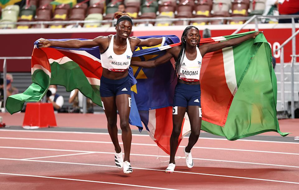 TOKYO, JAPAN - AUGUST 03:  Beatrice Masilingi of Team Namibia celebrates with her teammate and silver medal winner Christine Mboma after the Women's 200m Final on day eleven of the Tokyo 2020 Olympic Games at Olympic Stadium on August 03, 2021 in Tokyo, Japan. (Photo by Ryan Pierse/Getty Images)