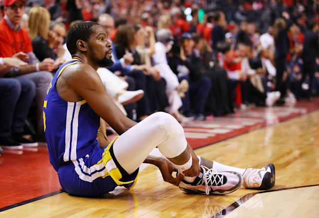 Kevin Durant #35 of the Golden State Warriors reacts after sustaining an injury during the second quarter against the Toronto Raptors during Game Five of the 2019 NBA Finals at Scotiabank Arena on June 10, 2019 in Toronto, Canada. (Photo by Gregory Shamus/Getty Images)