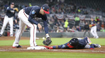 Atlanta Braves prospect Ronald Acuna Jr., dives back to first safely just under the tag of Freddie Freeman on a pickoff attempt by pitcher Sean Newcomb during the third inning of a baseball exhibition game Tuesday, March 27, 2018, in Atlanta. (Curtis Compton/Atlanta Journal-Constitution via AP)