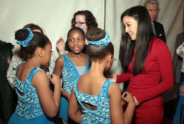 <p>In this April 7, 2014 file photo, Michelle Kwan, right, chats with students from Figure Skating Harlem, Emily Delbrun, left, Amber Stuart, front center, and Emmanuella Tapsoba, second left, during the 2014 Skating with the Stars benefit gala at the Trump Rink in Central Park in New York. Founded in 1997 by Sharon Cohen, who remains its executive director and guiding force, Figure Skating in Harlem's success story has been built on so much more than getting out on the ice. (Photo by Luiz C. Ribeiro/Invision/AP) </p>