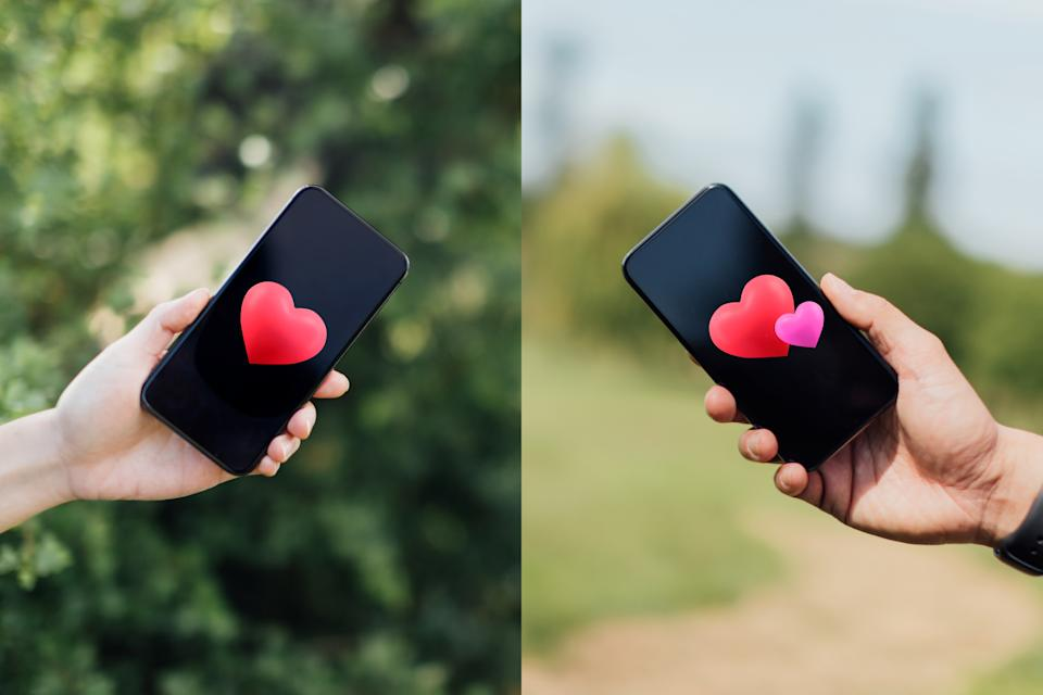 Two human hands holding two smartphones with a heart graphics on the screen in different places.
