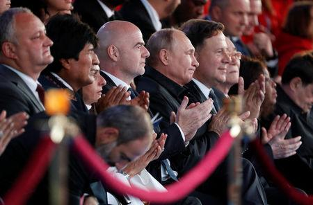 Russian President Vladimir Putin (5th L), FIFA President Gianni Infantino (4th L) and Bolivian President Evo Morales (2nd L) attend a gala concert, dedicated to the upcoming 2018 FIFA World Cup, in Red Square in Moscow, Russia June 13, 2018. Sergei Chirikov/Pool via REUTERS