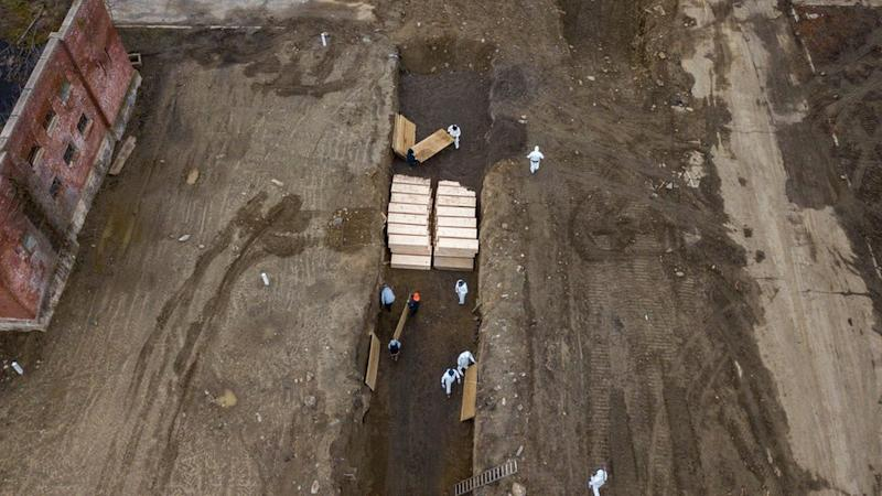Drone pictures show bodies being buried in a wide trench on New York's Hart Island