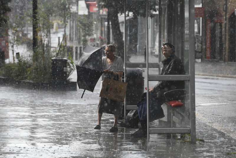 Rain pours, a day after the UK's second hottest day in July ever recorded, in Wanstead in north east London, Friday July 26, 2019. Temperature records that had stood for decades and sometimes hours have toppled across Europe during the second heat wave of the summer. The temperature in Paris hit 42.6 degrees Celsius, (108.7 degrees Fahrenheit) on Thursday, an all-time record. (Stefan Rousseau/PA via AP)