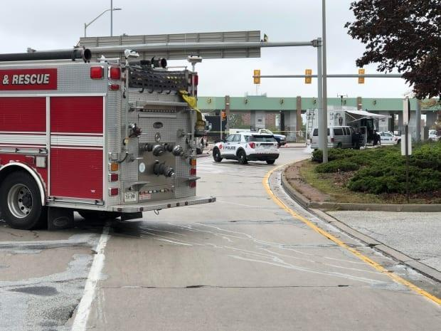 Traffic along the Ambassador Bridge connecting Windsor, Ont., and Detroit was affected Monday morning as police responded to 'possible explosives' near the border crossing. (Darrin Di Carlo/CBC - image credit)