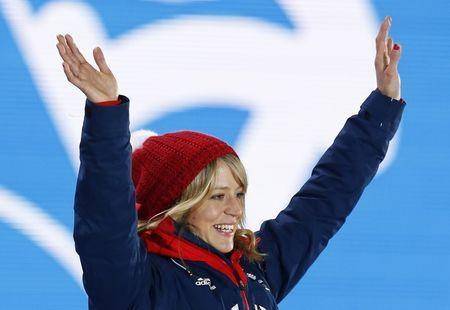 FILE PHOTO: Bronze medalist Jenny Jones of Britain poses on the podium after the women's snowboard slopestyle event at the Sochi 2014 Sochi Winter Olympics, February 9, 2014. REUTERS/Shamil Zhumatov