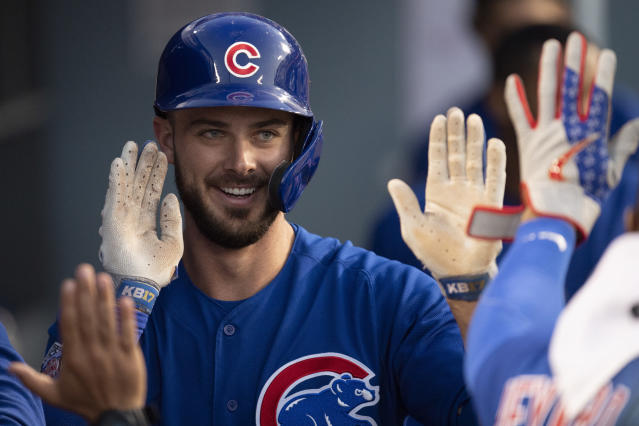 Chicago Cubs' Kris Bryant smiles in the dugout after his solo home run during the third inning of the team's baseball game against the Los Angeles Dodgers in Los Angeles, Friday, June 14, 2019. (AP Photo/Kyusung Gong)
