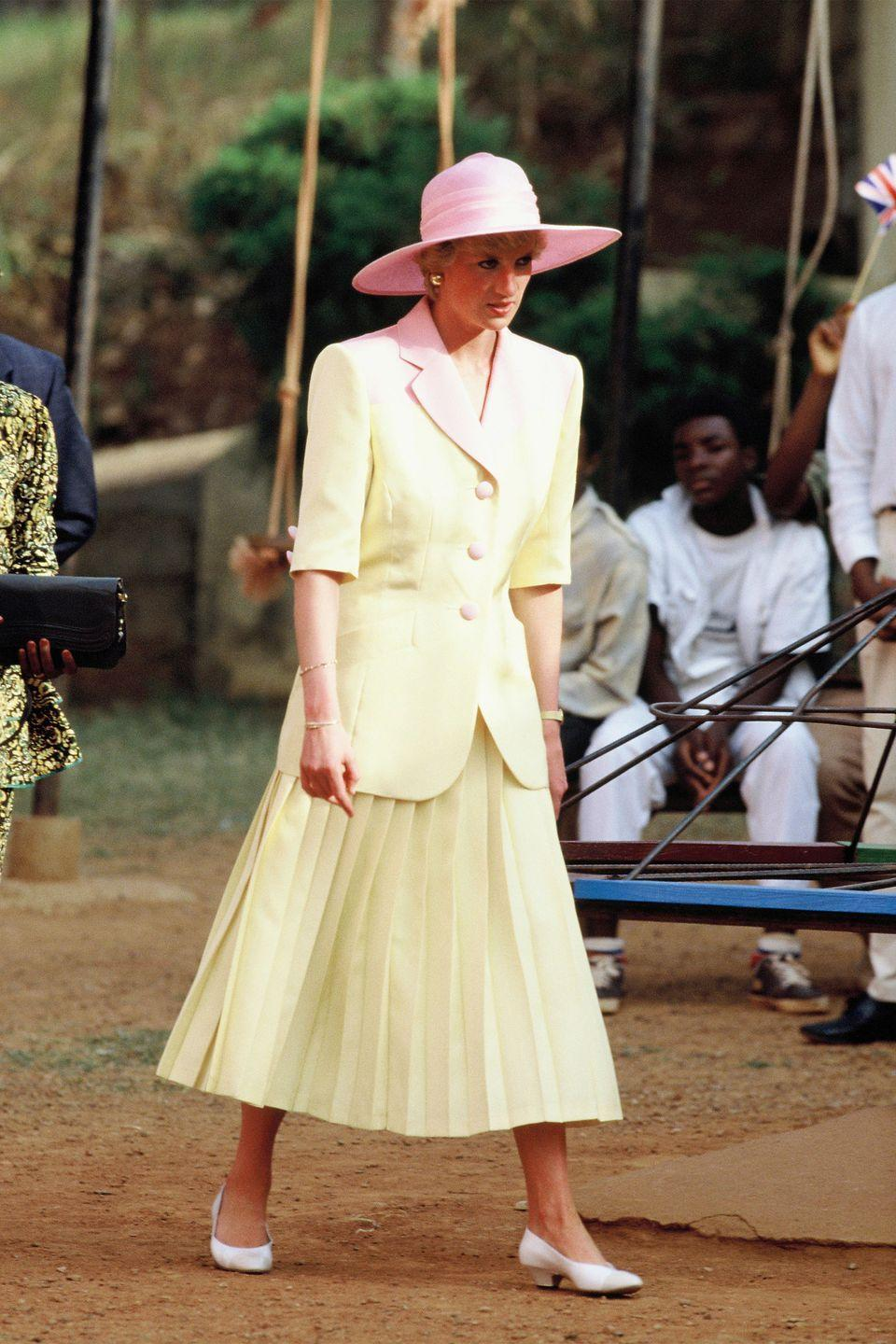 <p>In a suit by Catherine Walker and hat by Philip Somerville on a visit to Cameroon. </p>