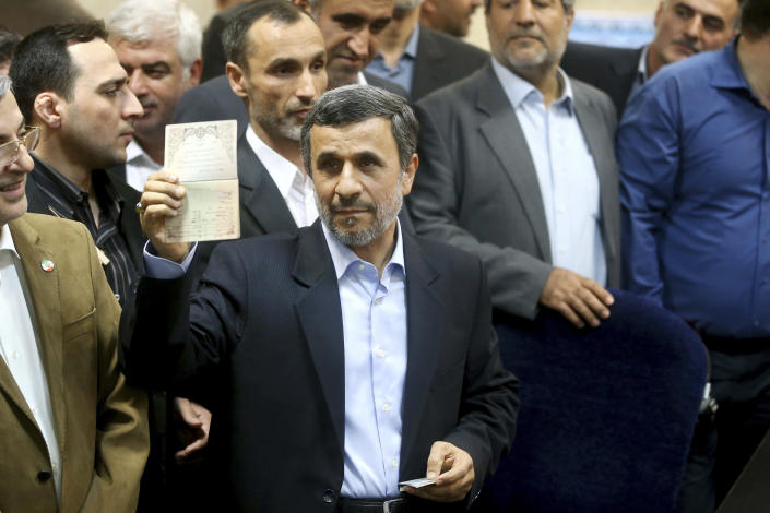 Former Iranian President Mahmoud Ahmadinejad shows his identification during registering his candidacy for the upcoming presidential elections at the Interior Ministry in Tehran, Iran, Wednesday, April 12, 2017. Ahmadinejad on Wednesday unexpectedly filed to run in the country's May presidential election, contradicting a recommendation from the supreme leader to stay out of the race. (AP Photo/Ebrahim Noroozi)
