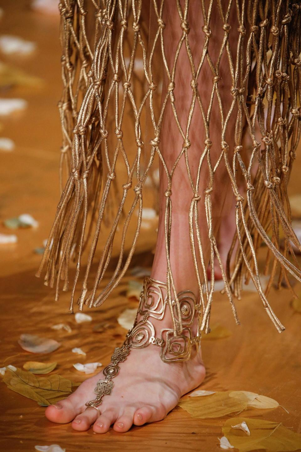 """<p>First rule of couture club: never let those well-groomed toes touch the ground. <a href=""""http://www.valentino.com/us"""" rel=""""nofollow noopener"""" target=""""_blank"""" data-ylk=""""slk:Valentino"""" class=""""link rapid-noclick-resp"""">Valentino </a>offers filigreed feet jewelry for indoor use only. <i>Photos: Imaxtree</i> </p>"""