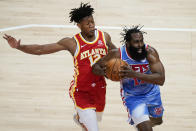 Brooklyn Nets' James Harden (13) is defended by Atlanta Hawks' De'Andre Hunter (12) during the first half of an NBA basketball game Wednesday, Jan. 27, 2021, in Atlanta. (AP Photo/Brynn Anderson)