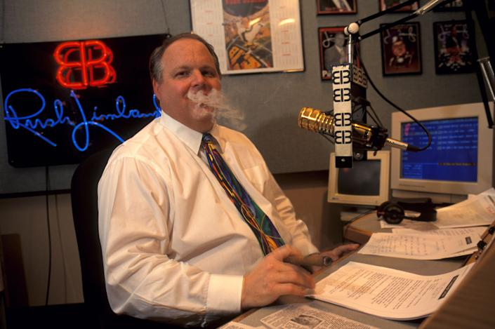 Rush Limbaugh smoking a cigar while taping his radio show. (Photo: mark peterson via Getty Images)