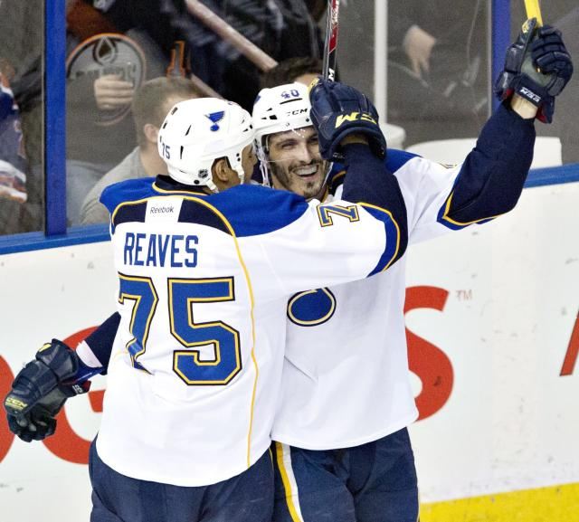 St. Louis Blues' Ryan Reaves (75) and Maxim Lapierre (40) celebrate a goal against the Edmonton Oilers during second period NHL hockey action in Edmonton, Canada, Tuesday, Jan. 7, 2014. (AP Photo/The Canadian Press, Jason Franson)