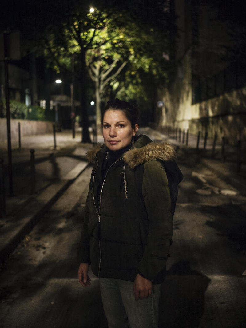 Mathilde, 31, a jewelry student from Marseille, poses for a portrait in Paris. Mathilde experienced domestic violence when she was 21. Ten years later, she finally took back control of her life. Pasting is for her the way not to be a victim anymore and take back control of her fear. (Photo: Kamil Zihnioglu/AP)