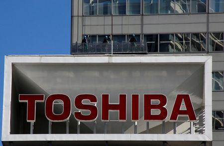FILE PHOTO: The logo of Toshiba Corp is seen as window cleaners work on the company's headquarters in Tokyo, Japan, February 14, 2017. REUTERS/Toru Hanai/File Photo