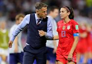 Philip Neville, Head Coach of England talks to Alex Morgan of the USA following the 2019 FIFA Women's World Cup France Semi Final match between England and USA at Stade de Lyon on July 02, 2019 in Lyon, France. (Photo by Elsa/Getty Images)