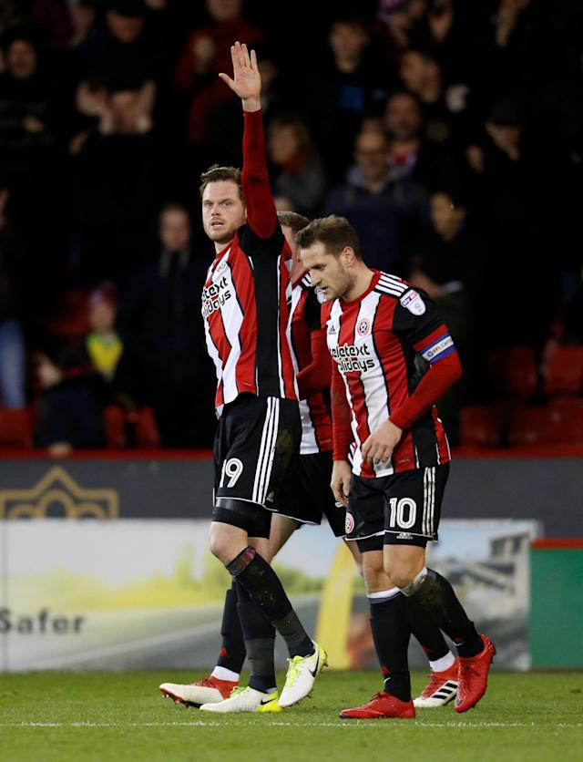 "Soccer Football - Championship - Sheffield United vs Queens Park Rangers - Bramall Lane, Sheffield, Britain - February 20, 2018 Sheffield United's Richard Stearman celebrates scoring their first goal with team mates Action Images/Ed Sykes EDITORIAL USE ONLY. No use with unauthorized audio, video, data, fixture lists, club/league logos or ""live"" services. Online in-match use limited to 75 images, no video emulation. No use in betting, games or single club/league/player publications. Please contact your account representative for further details."