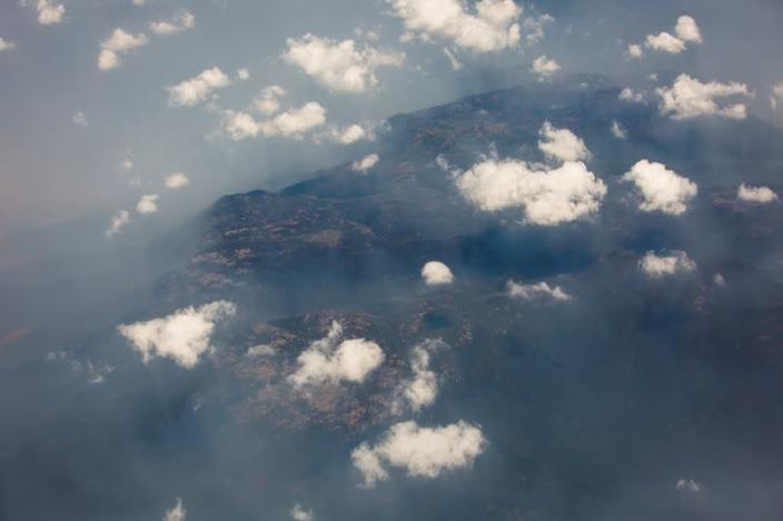 Smoke and haze over mountains are seen from a No 11 Squadron P-8A Poseidon conducting damage assessment and surveillance in the bushfire-affected area near Cooma