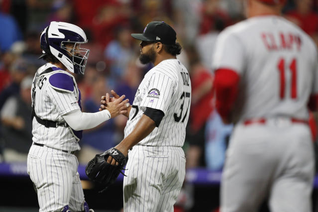 Colorado Rockies catcher Tony Wolters, let, congratulates relief pitcher Jairo Diaz after the Rockies defeated the St. Louis Cardinals 2-1 in a baseball game Wednesday, Sept. 11, 2019, in Denver. (AP Photo/David Zalubowski)