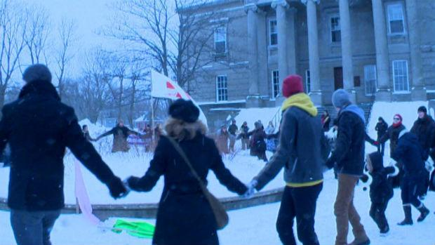 Idle No More supporters formed a circle in front of Colonial Building during a demonstration on Sunday.