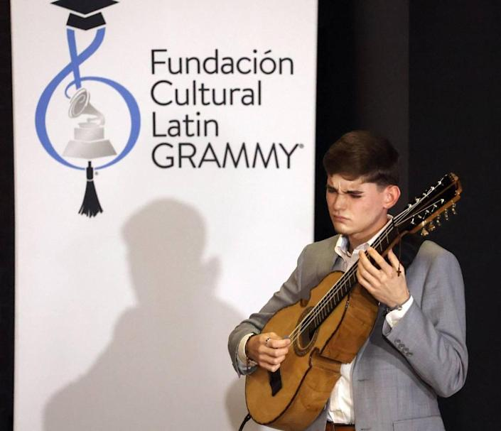 The winner of Juanes Scholarship, Xavier Cintrón, performs with Juanes on Tuesday, July 13, 2021 in Miami.