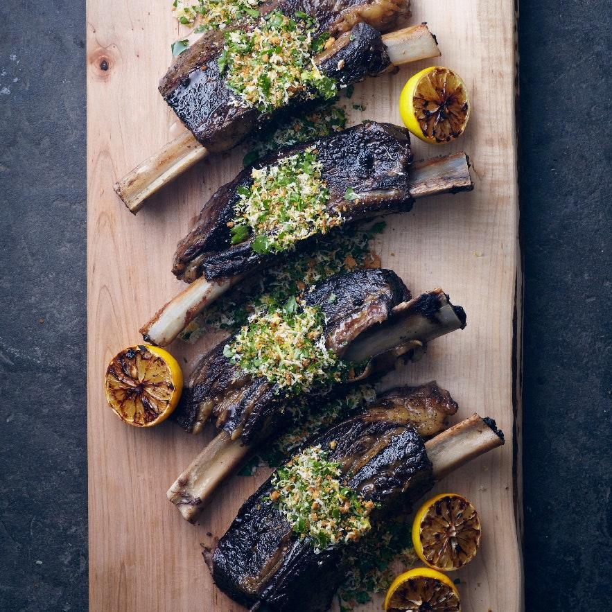 "English short ribs are cut lengthwise along the bone, so the meat sits on top. With a day or two of notice, any butcher should be able to cut them to order. <a href=""https://www.epicurious.com/recipes/food/views/slow-cooked-short-ribs-with-gremolata-51205070?mbid=synd_yahoo_rss"" rel=""nofollow noopener"" target=""_blank"" data-ylk=""slk:See recipe."" class=""link rapid-noclick-resp"">See recipe.</a>"