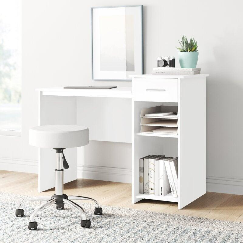 """<h2>Dotted Line Brynn Desk</h2><br><strong>Flash Deal: 27% off </strong><br>This desk wins the storage award thanks to its multiple shelving units and sleek design. Use it as a WFH desk, vanity, bookcase, and anything you can think of. <br><br><em>Shop</em> <strong><em><a href=""""https://www.wayfair.com/brand/bnd/dotted-line-b52372.html"""" rel=""""nofollow noopener"""" target=""""_blank"""" data-ylk=""""slk:Dotted Line"""" class=""""link rapid-noclick-resp"""">Dotted Line</a></em></strong><br><br><br><strong>Dotted Line</strong> Brynn Desk, $, available at <a href=""""https://go.skimresources.com/?id=30283X879131&url=https%3A%2F%2Fwww.wayfair.com%2Ffurniture%2Fpdp%2Fdotted-line-brynn-desk-w001991082.html"""" rel=""""nofollow noopener"""" target=""""_blank"""" data-ylk=""""slk:Wayfair"""" class=""""link rapid-noclick-resp"""">Wayfair</a>"""