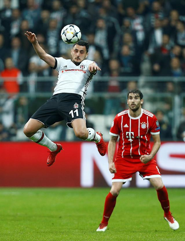 Soccer Football - Champions League Round of 16 Second Leg - Besiktas vs Bayern Munich - Vodafone Arena, Istanbul, Turkey - March 14, 2018 Besiktas' Mustafa Pektemek in action with Bayern Munich's Javi Martinez REUTERS/Osman Orsal