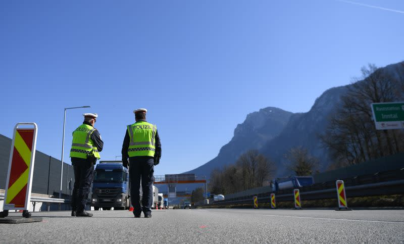 Austrian police officers control cars at the Austrian-German border crossing point near Kufstein
