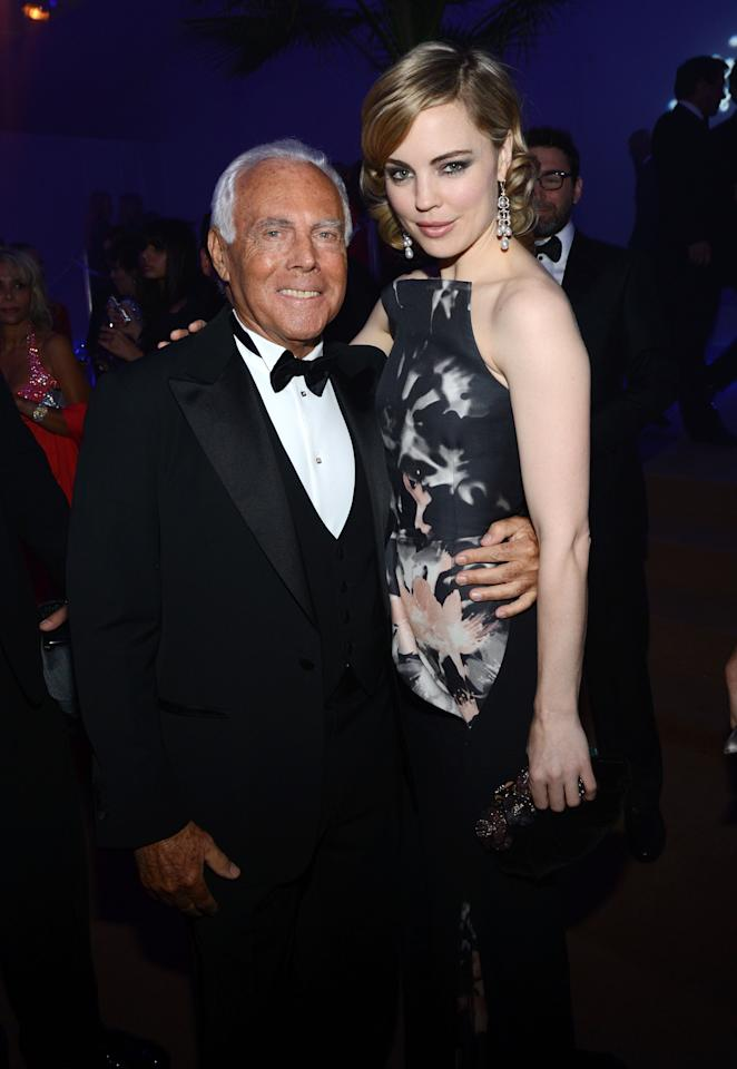 CANNES, FRANCE - MAY 18:  Designer Giorgio Armani and actress Melissa George attend the Haiti Carnival in Cannes Benefitting J/P HRO, Artists for Peace and Justice & Happy Hearts Fund Presented By Armani during the 65th Annual Cannes Film Festival on May 18, 2012 in Cannes, France.  (Photo by Michael Buckner/Getty Images)