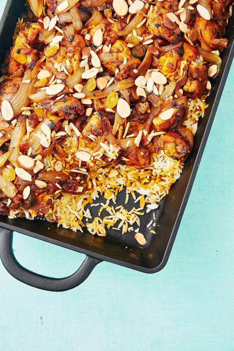 """<p>Chicken biryani is such an easy and delicious dinner idea. Loaded with gorgeous chicken, onions and spices, we love the addition of raisins and almonds, too. YUM!</p><p>Get the <a href=""""https://www.delish.com/uk/cooking/recipes/a28868967/chicken-biryani/"""" rel=""""nofollow noopener"""" target=""""_blank"""" data-ylk=""""slk:Chicken Biryani"""" class=""""link rapid-noclick-resp"""">Chicken Biryani</a> recipe.</p>"""