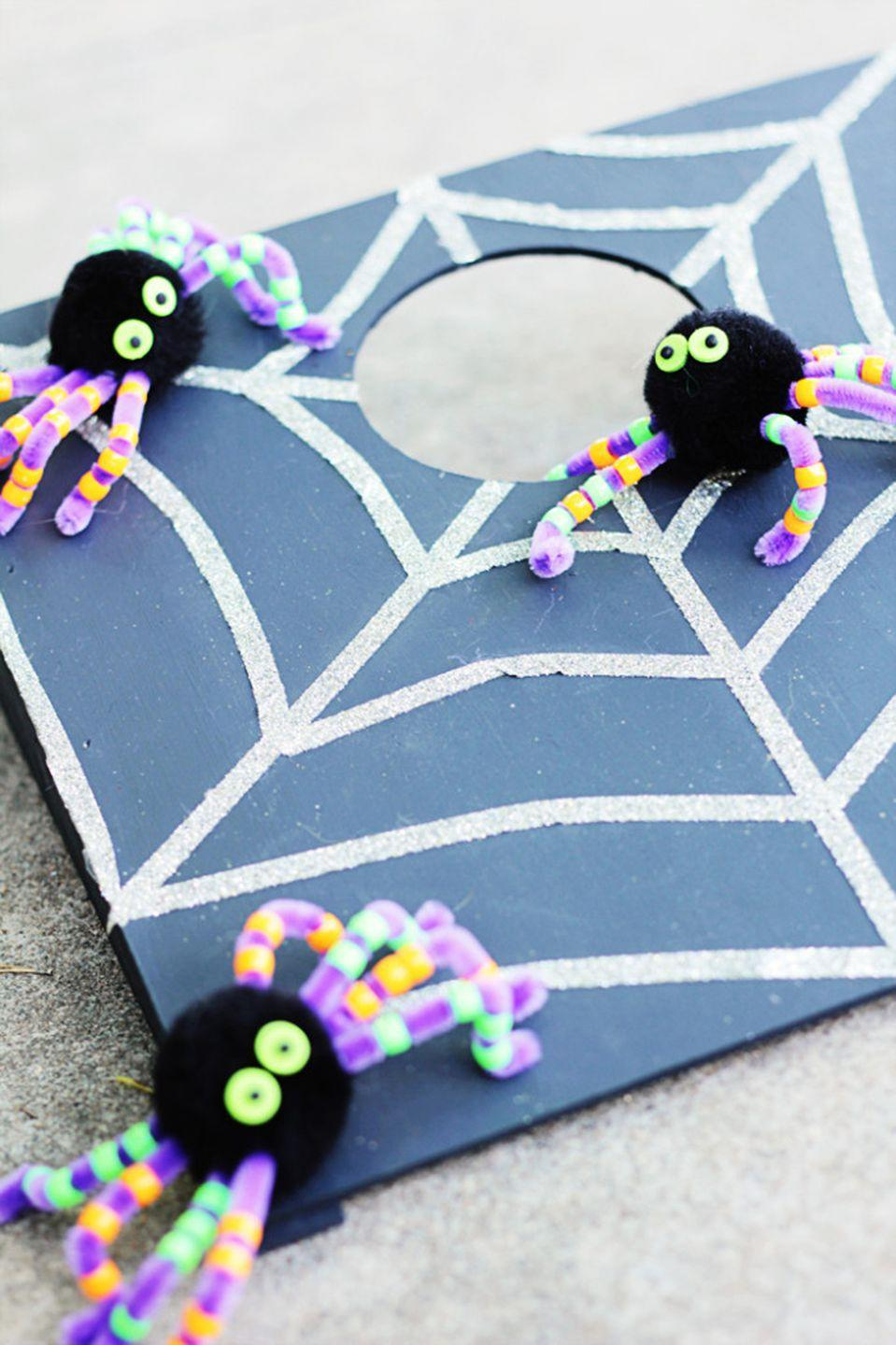 "<p>Give cornhole a Halloween update by painting a web onto the board and subbing in toy spiders in place of the bean bags.</p><p><strong>Get the tutorial at <a href=""http://blog.consumercrafts.com/kids-stuff/cornhole-halloween-game/"" rel=""nofollow noopener"" target=""_blank"" data-ylk=""slk:Crafts Unleashed"" class=""link rapid-noclick-resp"">Crafts Unleashed</a>.</strong></p><p><a class=""link rapid-noclick-resp"" href=""https://www.slickwoodys.com/collections/country-living-cornhole"" rel=""nofollow noopener"" target=""_blank"" data-ylk=""slk:SHOP CORNHOLE GAMES"">SHOP CORNHOLE GAMES</a><br></p>"