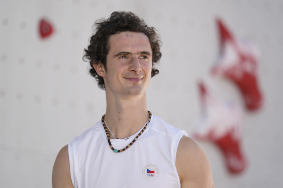 Adam Ondra, of the Czech Republic, smiles after completing the second heat during the speed qualification portion of the men's sport climbing competition at the 2020 Summer Olympics, Tuesday, Aug. 3, 2021, in Tokyo, Japan. (AP Photo/Jeff Roberson)