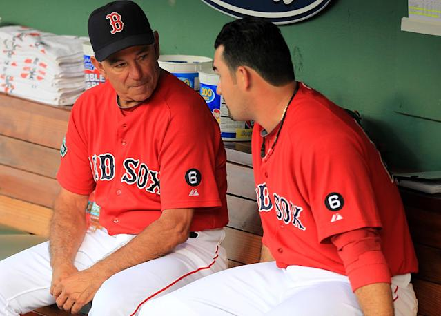 BOSTON, MA - AUGUST 24: Bobby Valentine #25 of the Boston Red Sox chats with Adrian Gonzalez #28 of the Boston Red Sox before a game with the Kansas City Royals at Fenway Park on August 24, 2012 in Boston, Massachusetts. (Photo by Jim Rogash/Getty Images)