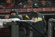 Oakland Athletics manager Bob Melvin, right, gestures during the seventh inning of an exhibition baseball game against the San Francisco Giants in San Francisco, Monday, March 25, 2019. (AP Photo/Jeff Chiu)