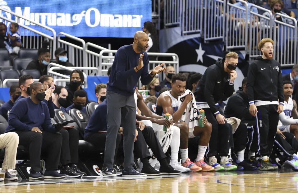 Orlando Magic head coach Jamahl Mosley cheers on his team during the second half of an NBA basketball game against the San Antonio Spurs, Sunday, Oct. 10, 2021, in Orlando, Fla. (AP Photo/Jacob M. Langston)