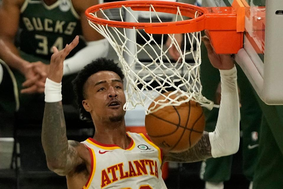 John Collins is averaging 14.6 points and 8.8 rebounds while shooting 56.1% from the field and 36.6% on 3-pointers in the postseason.