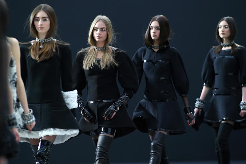 Models wear creations by German fashion designer Karl Lagerfeld for Chanel's Fall/Winter 2013-2014 ready to wear collection, in Paris, Tuesday, March, 5, 2013. (AP Photo/Thibault Camus)