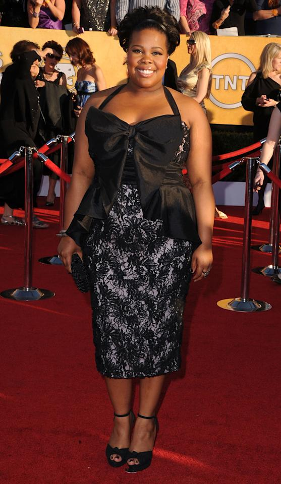 Amber Riley arrives at the 18th Annual Screen Actors Guild Awards at The Shrine Auditorium in Los Angeles, California.