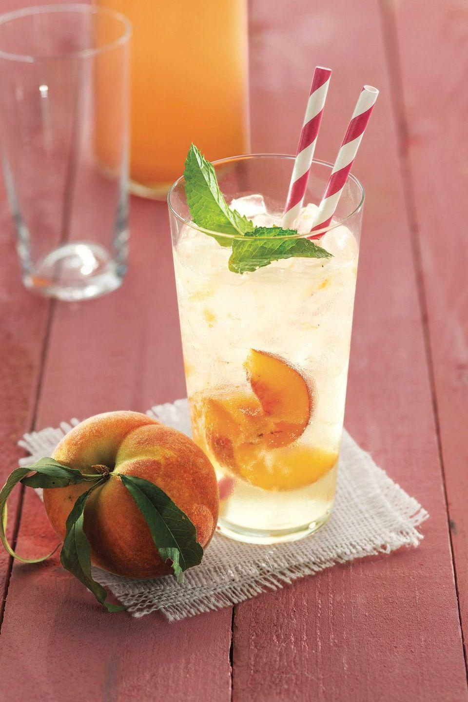 """<p>Since you're already mixing drinks for the adults at your party, give the kids something special to sip on with this made-from-scratch peach drink. (If adults want to join in on the fun, just add a splash of rum.)</p><p><em><a href=""""https://www.countryliving.com/food-drinks/recipes/a4421/ginger-peach-soda-recipe-clv0613/"""" rel=""""nofollow noopener"""" target=""""_blank"""" data-ylk=""""slk:Get the recipe from Country Living »"""" class=""""link rapid-noclick-resp"""">Get the recipe from Country Living »</a></em></p>"""