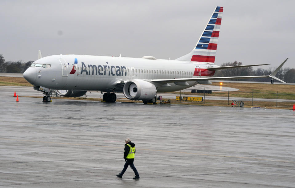 An American Airlines Boeing 737 Max jet plane is parked at a maintenance facility in Tulsa, Okla., Wednesday, Dec. 2, 2020. American Airlines took its long-grounded Boeing 737 Max jets out of storage, updating key flight-control software, and flying the planes in preparation for the first flights with paying passengers later this month. (AP Photo/LM Otero)