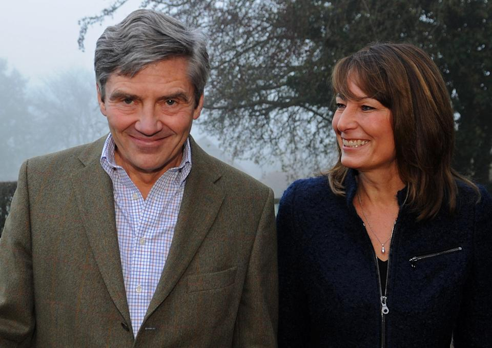 Michael and Carole Middleton, the parents of Britain's Prince William's fiancée Kate, pose for a photograph at their home in Berkshire, southern England on November 16, 2010.  Britain's Prince William will marry long-term girlfriend Kate Middleton next year, ending feverish speculation about when the second-in-line to the throne would wed, the royal family announced Tuesday.  William, the eldest son of heir to the throne Prince Charles and the late Princess Diana, and Middleton, the daughter of a wealthy businessman, got engaged in October while on holiday in Kenya, said Clarence House, Charles' official residence.              AFP PHOTO / STEFAN ROUSSEAU / POOL (Photo credit should read STEFAN ROUSSEAU/AFP via Getty Images)