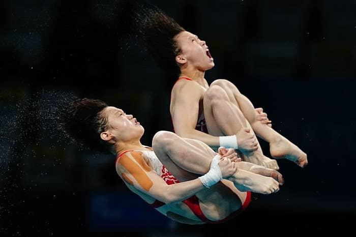 Two divers hurtling through the air