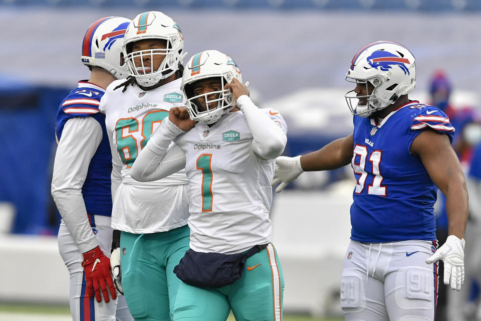 Miami Dolphins quarterback Tua Tagovailoa (1) reacts after being sacked in the first half against Buffalo. (AP Photo/Adrian Kraus)