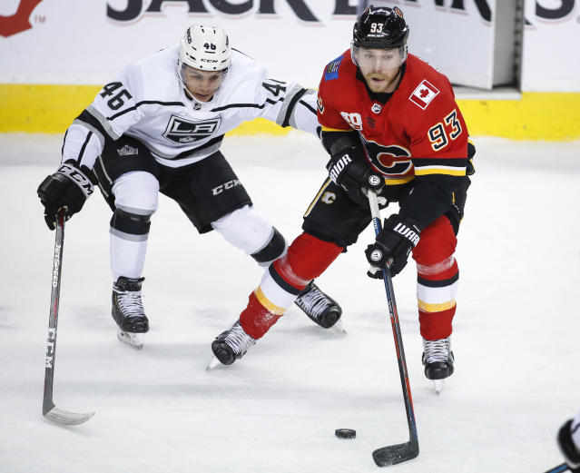 Los Angeles Kings' Blake Lizotte, left, chases Calgary Flames' Sam Bennett during the first period of an NHL hockey game Tuesday, Oct. 8, 2019, in Calgary, Alberta. (Jeff McIntosh/The Canadian Press via AP)