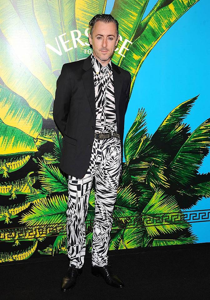 """The Good Wife's"" Alan Cumming turned heads (in a bad way) at the star-studded Versace for H&M Fashion fete on Tuesday in a geometric, seizure-inducing suit. (11/8/2011)"