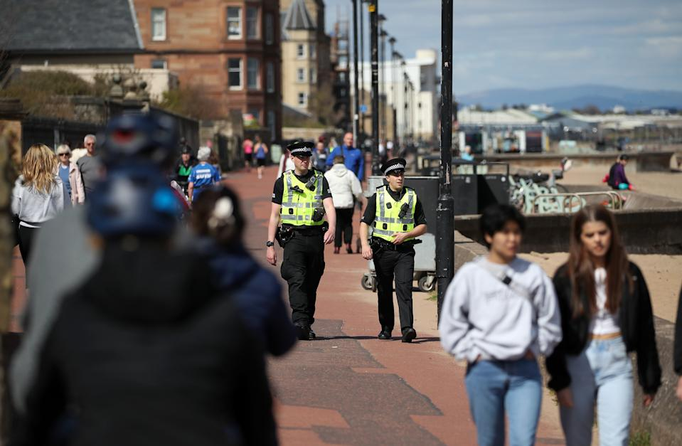 Police officers patrol the beach front at Portobello as the UK continues in lockdown to help curb the spread of the coronavirus.