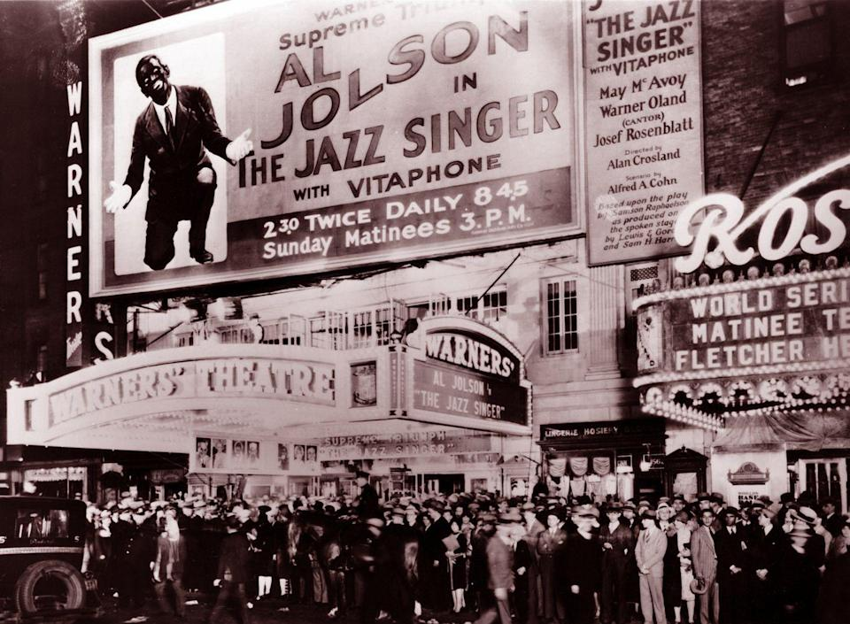 "<p>The marquee shines bright at the 1927 premiere of <em>The Jazz Singer. </em> The movie marked the first feature-length production to have a picture with synchronized dialogue sequences, ushering in a new era of ""talkies"" and bringing an end to the silent film era. </p>"
