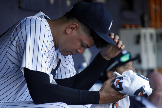 New York Yankees relief pitcher Dellin Betances reacts in the dugout during the eighth inning of a baseball game against the Toronto Blue Jays on Sunday, Sept. 16, 2018, in New York. (AP Photo/Adam Hunger)